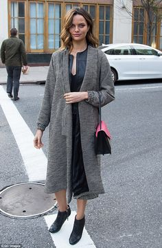 Angelic: Barbara Fialho, who hails from Brazil, was chic in a long coat and ankle boots...