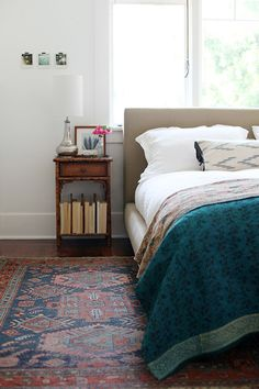 bedroom colourful but tranquil. Love the idea of a vintage kelim by the bed.