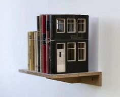 Dutch artist Frank Halmans transforms ordinary stacks of books into charming little buildings. For his series Built of Books, Halmans carves squares and rectangles into old textbooks and binds them altogether like a quaint little town made of rows of narrow buildings.