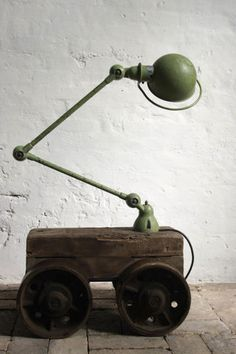 A great way for a Jielde lamp to stand on an industrial item on wheels. Great color as well! #LaBoutiqueVintage Visit our Jielde lamps at www.laboutiquevintage.co.uk