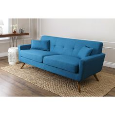 Add a classic retro mid century modern touch to your living space with this luxurious blue linen tufted sofa on top of natural wood legs and filled with high density foam cushioning to fit into any style and decor. Mid Century Modern Sofa, Mid Century Modern Furniture, Tufted Sofa, Hollywood Regency, Sofa Furniture, Contemporary Furniture, Tuxedo, Interior Styling, Natural Wood