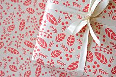 Red Hollies on Kraft Gift Wrap ($8): Most holly-based patterns walk the way-too-cheesy line but this graphic answer to holly is right up our alley. It could even work for non-Christmas presents.