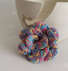 A beautiful multicolour rose either mounted on a hair slide or a bobble. This crochet flower is a fun funky piece for any girl to add to her hair for a party or everyday wear.  I have a lovely dog called Meg, and while I do my best to keep her fur away from my work, there may be the odd stray hair that arrives as well.  The rose is 10 cm (4 inches) in diameter. The metal slide is 5cm (2 inches) long. The bobble is black. Rose Hair Clip, Hair Slide, Crochet Flowers, Different Styles, Her Hair, Raspberry, Fashion Accessories, Tropical
