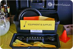 tool box to hold plate, cutlery and napkins.  Use black and red plates, napkins, etc