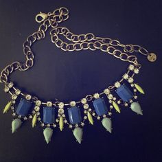 Blue and green Statement necklace Blue and green necklace with gold chain! Great condition. If interested, I am willing to negotiate! LOFT Jewelry Necklaces