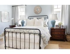 The black iron bed is the perfect piece in this blue and white bedroom ... #coachbarn #ironbeds