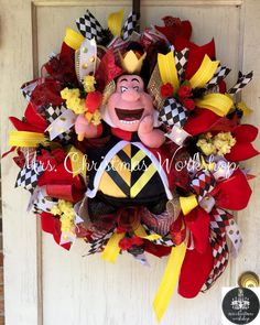 Private Listing  This is a deco mesh queen of hearts wreath! Alice in wonderland theme features a Disney plush. No one else in the neighborhood will have a wreath like this!! Measures 24H x 24W this wreath will need to be hung in a protected area or under an overhang to extend life!  READY TO SHIP!  See more items http://www.etsy.com/shop/mrschristmasworkshop