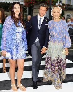High society: The artist and her boyfriend were pictured alongsideFranca Sozzani,the edi...