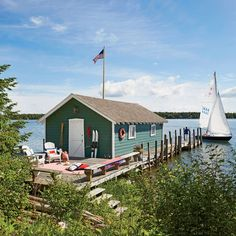 This charming cottage's Lake Huron boathouse was built in the 1940s. | Coastalliving.com