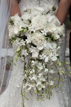 An all white cascade wedding bouquet ...