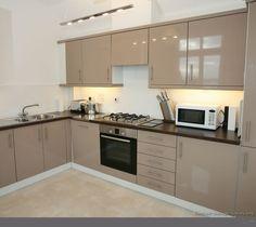 Kitchens featuring beige kitchen cabinets in modern styles