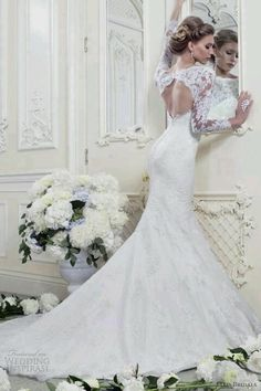 Very pretty. Don't usually like wedding dresses with sleeves but this I like