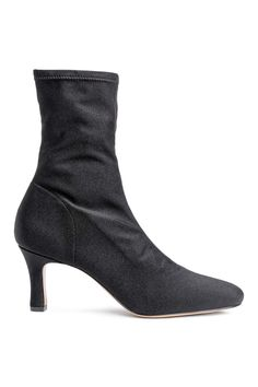 7851e6cee896a Ankle boots in glossy jersey with rounded toes, covered heels, and soft  stretch leg section. Satin lining, faux leather insoles, and rubber soles.