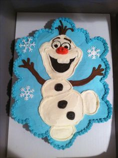 "Olaf from Disney's Frozen. 24 cupcakes made into a ""pull-apart"" cake, decorated with American buttercream."