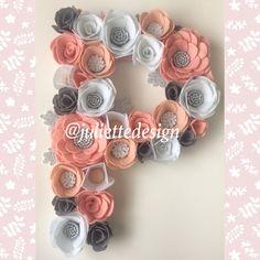 A personal favorite from my Etsy shop https://www.etsy.com/listing/565455273/floral-letter-felt-flower-letter-nursery