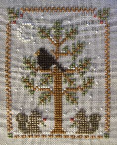 Christmas ornament cross stitch tree squirell LOVE THIS ONE. WHO'S IT BY AND IS THERE A WHOLE SERIES?