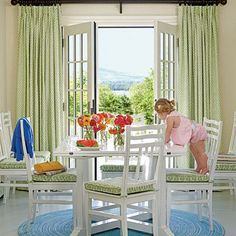 Floor-to-ceiling window treatments in a green, graphic print make a statement and frame the view in this breakfast room, drawing the focus to the world outside. | Coastalliving.com