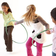 hula hoop game-- Ask the kids to stand in a big circle, slip a hula hoop onto one child's arm, and have them all join hands. They then must find a way to move the hula hoop all the way around the circle without letting go of each other's hands.