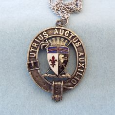 Offering this fun 60s vintage pendant with a Latin motif. The message is Utrius Auctus Auxilio. It means 'By the Help of God' said to have been