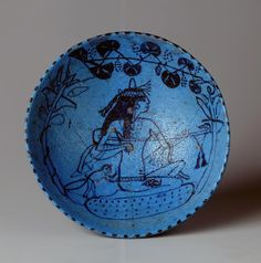 "Wine bowl with female lute player. ""A rare specimen made of deep blue glazed faience."" Egypt, ca. 1400-1300 BCE. (Collection of Rijksmuseum van Oudheden)"
