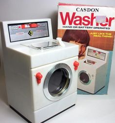 Washing Machine by Casdon Toys.1970's.  It really worked! My favourite toy.
