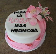 """""""For the Rose more Beautiful"""" cake for a mother named Rosa. Red Velvet cake with cream cheese filling. Gumpaste Rose, Orchid, and Starburst Lily. Covered in fondant with a pink fondant drape."""