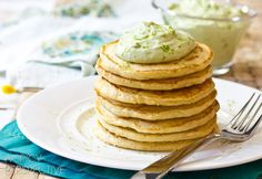 Tender buttery corn cakes are a wonderful addition to a hearty breakfast. Topped with silky avocado cream, these savory lime corn cakes are a hit for breakfast!
