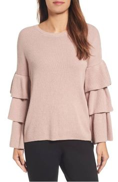 Sleeves tiered with ribbed ruffles put an of-the-moment spin on a cozy cotton-blend pullover knit with a kiss of cashmere. From Halogen