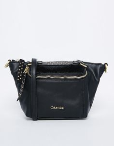 """Bag by Calvin Klein Smooth leather-look fabric Twill lining Zip top opening Front zip pocket Faux pony hair trim Zipped inner pocket Detachable strap Wipe with a damp cloth 100% Polyurethane H: 17cm/7"""" W: 16cm/6"""" D: 8cm/3"""""""