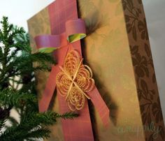 Recycling tip: Use your wrapping paper scraps to make paper ribbons. So easy! (tutorial on blog)