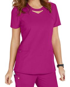 Let your Careisma shine! The keyhole top from Careisma by Sofia Vergara puts a cute and unique twist on the typical scrub top! This modern fit scrub top features roomy angled pockets and a removable wristlet inside the right pocket. The luxurious stretch fabric feels fantastic to wear throughout your shift. Back princess seams will flatter your shape. Careisma By Sofia Vergara Fearless Keyhole Scrub Tops Round neckline with peek-a-boo detail Two angled pockets Wristlet inside the rig...