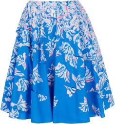Blue cotton A-line skirt featuring an ecru & pink leaf print with flared pleated hem.