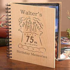 75th Birthday Photo Album - Delightful wooden album is a thoughtful gift.  If you're having a party, bring a permanent marker along and have all the guests sign the photo album.