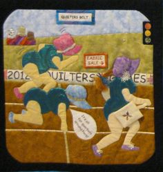 """""""Quilters Bolt"""". A takeoff on the Olympic Games.  Festival of Quilts 2012, photo by Viviane at ViDerTextil (Belgium).  Click to see the quotations!"""