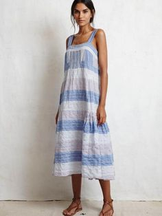 BISCAYDRESS FROM WARM IN CONTRASTING CHAMBRAY STRIPE.SQUARE NECKLINE WITH THICK STRAPS. TIERED HEM. Made in the USA Color-CHAMBRAY STRIPE Fabric- 100%COTTO