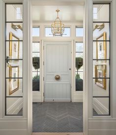 Love the art & pictures lights hanging so to create symmetry and drama as you enter the home