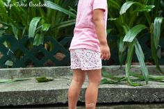 If your daughter is too active for dresses, make these Summer Kids' DIY Shorts to put under the dresses for her to be cool and comfortable in the summer sun. These DIY shorts are technically short leggings made out of cotton fabric and elastic. Sewing Patterns For Kids, Sewing For Kids, Free Sewing, Sewing Ideas, Sewing Projects, Knitting Patterns, Sewing Baby Clothes, Free Clothes, Diy Shorts