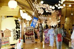 Oedo Onsen Monogatari.  Visitors change into cotton yukata robes and pass through a central area styled after a traditional Japanese festival with games and food stalls before reaching the complex's numerous bathing areas, including a foot bath/walking path in the open-air garden.