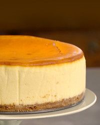 "This recipe for New York-style cheesecake, adapted from ""Martha Stewart's Baking Handbook,"" makes a smooth and creamy dessert that everyone will love."