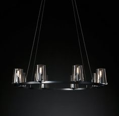 "RH's Pauillac Round Chandelier 36"":Created by renowned lighting designer Jonathan Browning, this chandelier distills the hurricane lamp to its essence. Inspired by French fixtures of the 1940s, its hand-blown shades are a traditional tapered shape, while the solid brass frame offers a modern counterpoint."