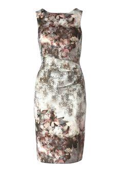 Jerseykleid    Elegantes Kleid aus Scubaware. Es ist komplett mit einem ausdrucksvollen Blumen und Snakeprint bedruckt, der auf dem grauen Untergrund besonders reizvoll hervortritt. Ein weiteres attraktives Detail: Das Rockteil ist im Taillenbereich vorne seitlich in Falten gelegt. Dadurch wird die skulpturale Wirkung der Scubaware noch betont. Das elegante Kleid wird hinten mit einem Reißversc...