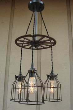 Upcycled Rusty Industrial Wheel Three Light Bulb by BenclifDesigns, $290.00 - now I know what to do with the rusty old meat grinder I found...