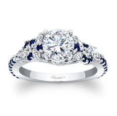 So in love! It's perfect. Vintage look with a splash of sapphire | Engagement+Ring+With+Blue+Sapphires+-+Engagement+Ring+With+Blue+Sapphires