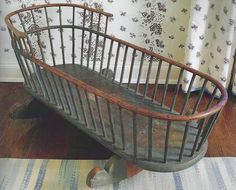 A Rare Blue-Painted Windsor Cradle, Pennsylvania, Circa an extremely rare form of Windsor Furniture that retains most of its original blue paint; bottom and rockers are tiger maple, all bent parts are hickory, and the spindles are maple. Primitive Furniture, Primitive Antiques, Vintage Antiques, Vintage Items, Primitive Country, Vintage Wood, Antique Desk, Antique Furniture, Baby Cradle Plans
