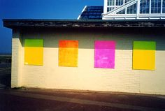 photograph Great Yarmouth building seaside norfolk coast colour vivid pink yellow sun sunshine poster site board