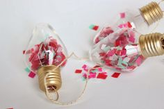 confetti-filled light bulb garland by @A Whole Lotta Love & lion #DIY #partyideas #loveandlion