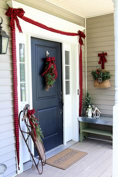 SIMPLE CHRISTMAS FRONT DOOR IDEAS-- A fresh take on the greenery swag - use a pretty ribbon instead!