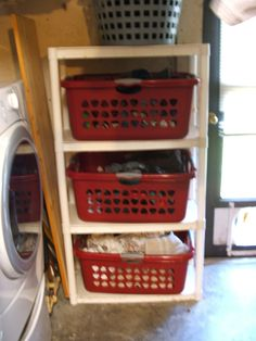 Laundry Organization - Purchased rack from Walmart for $10.00 and added laundry baskets to fit. Now even the dogs cannot get to the laundry.