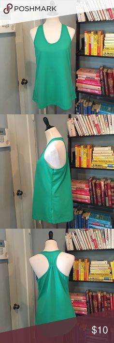 Turquoise Racer Back Workout Top EUC. Beautiful jem color and loose fitting for comfort. No damage or wear. hind Tops Tank Tops
