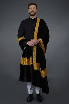 This is a black silk velvet dupatta shawl adorned with Kashmiri gold exquisite tilla embroidered pallav and borders. The embroidered borders are inches wide along the length of the dupatta and inches wide pallav borders along the width o Indian Wedding Guest Dress, Wedding Dresses Men Indian, Wedding Dress Men, Marriage Dress For Men, Designer Dress For Men, Designer Dresses, Wedding Kurta For Men, Achkan, Indian Men Fashion